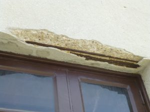 Spalled concrete due to corroded rebar